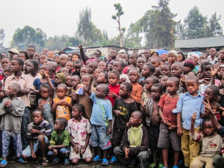 Children watching the music caravan.