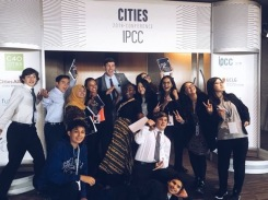 At the entrance to the IPCC conference the students pose with Edmonton Mayor Don Iveson.